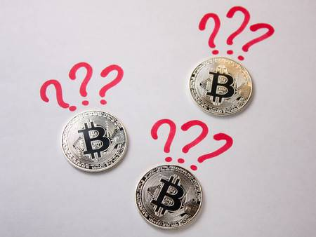 93298389-silver-coins-bitcoin-on-a-white-background-with-a-question-mark