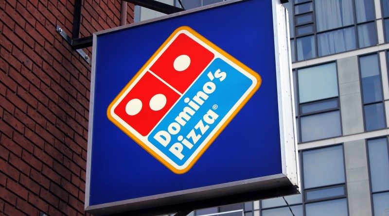 22059430 - dominos pizza restaurant sign