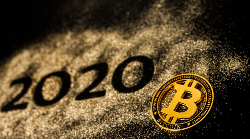 Happy New Year 2020 . Creative Collage of numbers two and zero made up the year 2020. Beautiful sparkling Golden number 2020 and bitcoin on black background for design